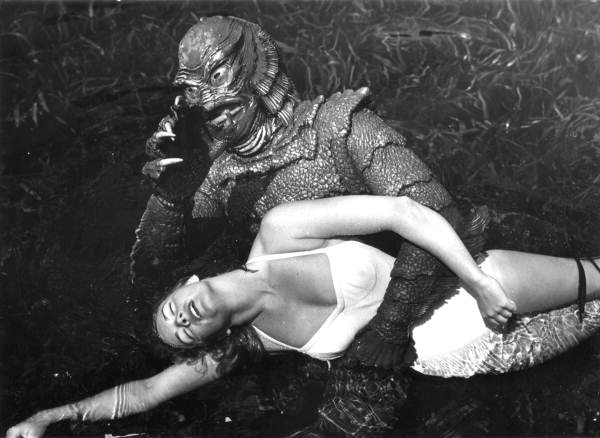 26. Ginger Stanley in the grip of the creature - Silver Springs, 1955