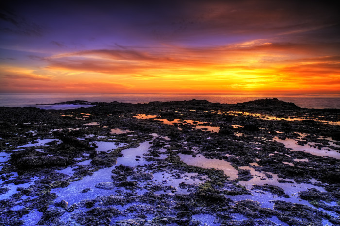 14.  Crescent Bay in Laguna Beach bathed in purple light. Wow!