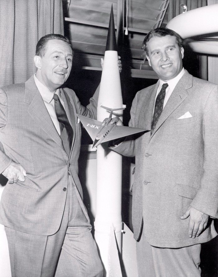7. In this photo, Dr. Wernher von Braun was visited by Walt Disney in 1954. During the 1950s, von Braun worked with Disney Studios as a technical director, making three films about space exploration for television.
