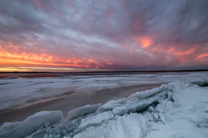 11. An icy landscape with a supernaturally-colored sky.