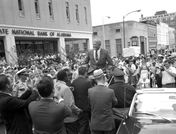 13. Dr. Wernher von Braun, the first center director of NASA's Marshall Space Flight Center, is being carried on top of the  city officials' shoulders during the Apollo 11 celebration in downtown Huntsville on July 24, 1969.