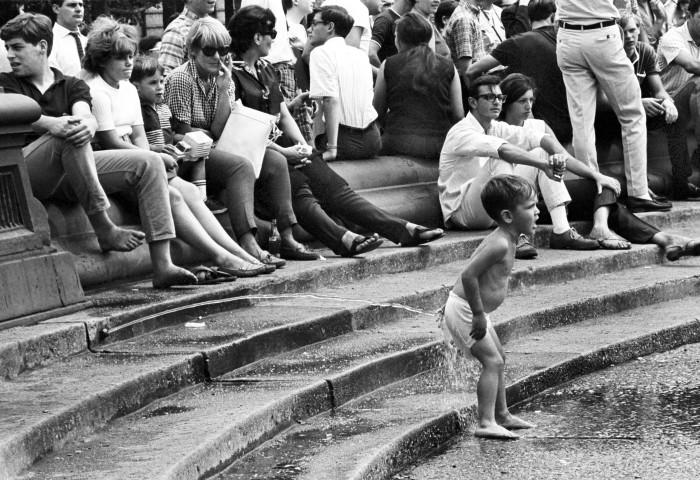 16. A boy enjoying the sensational Washington Square Park water fountain!