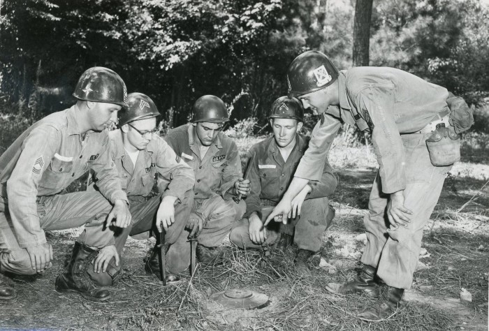 1. Fort McClellan, Alabama / August 30, 1955---Newnan Guardsman of Company C, 122nd Infantry provide instructions in landmine emplacement.