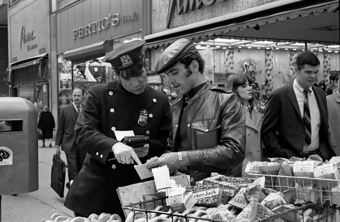 12. A city vendor receiving a ticket from a police officer.