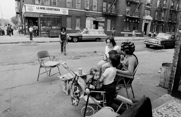 14. A Brooklyn corner captured in 1972, it's hard to make your eyes stray away from the vintage stroller!