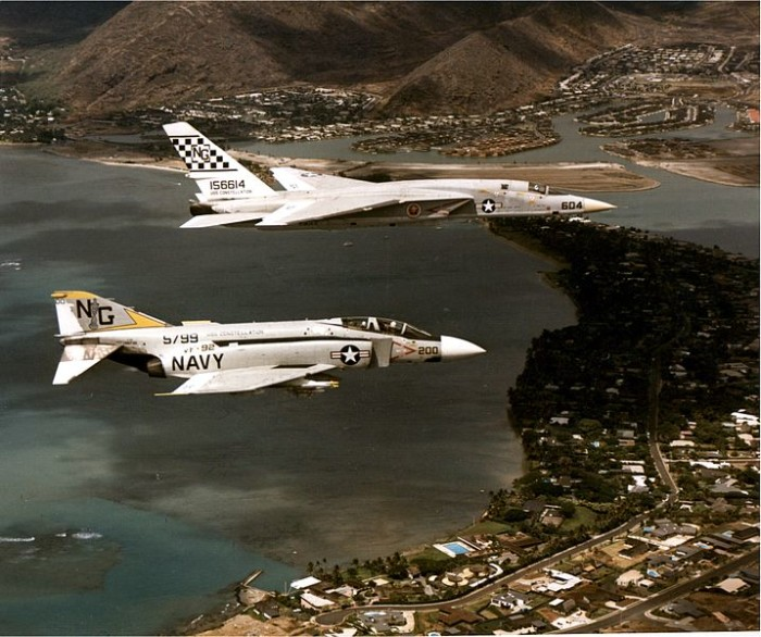 2. A U.S. Navy McDonnel Douglas F-4J Phantom II aircraft and a North American RA-5C Vigilante fly over Oahu in 1971 leading up to a combat deployment to Vietnam.