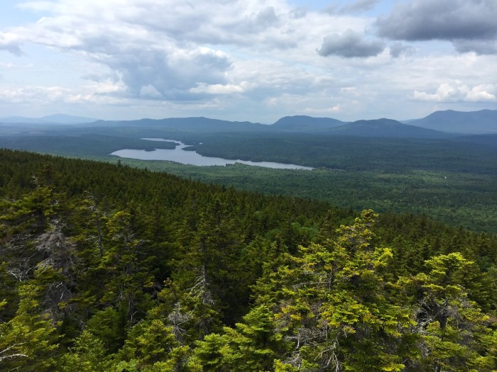 """5. """"In a world where one woman conquers the 100 mile wilderness with nothing but her Beans rucksack and bare feet to guide her..."""" At least she's got the view of Long Pond to ease her pain."""