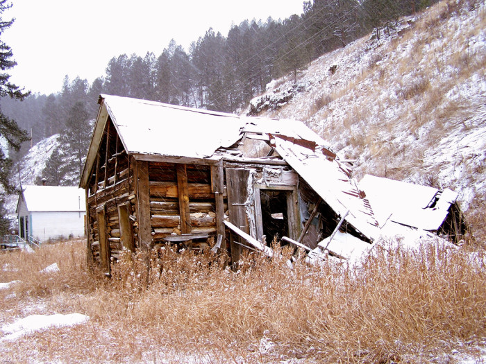 Abandoned cabin in the snow - spots in south dakota