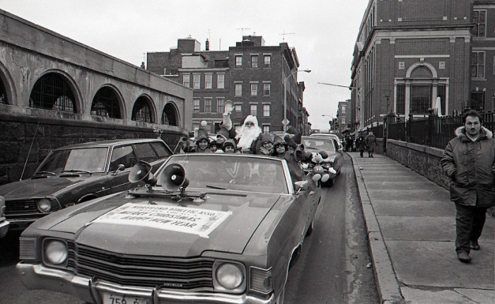 3. Santa Claus in car with children dressed as elves in the North End Christmas Parade, 1974.