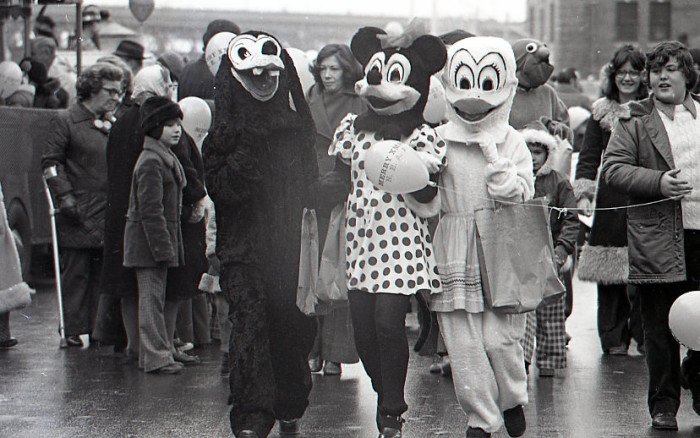 5. Characters in costume including Minnie Mouse and Donald Duck marching in North End Christmas Parade, 1974.