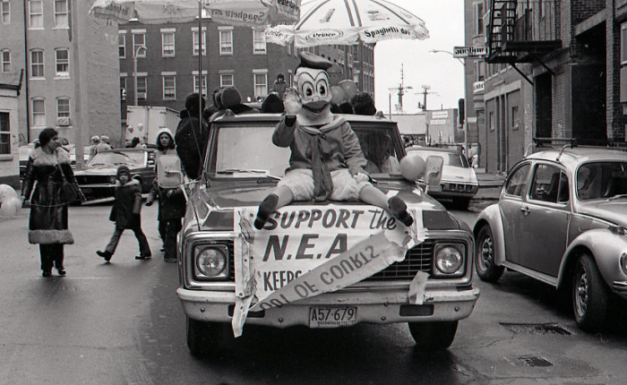 4. Donald Duck rides on the hood of a car in the North End Christmas Parade, 1974.