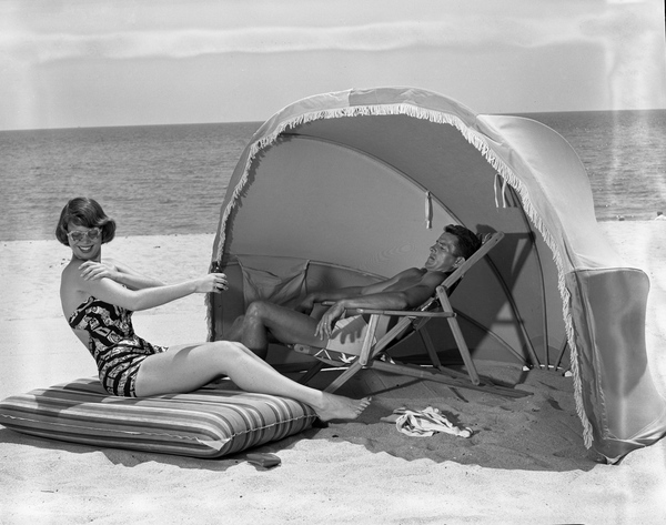 1. Couple relaxing at Miami Beach, 1950