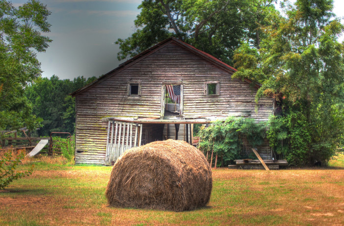 3. This rustic barn, featuring a patriotic American Flag, is located in Clopton, Alabama.
