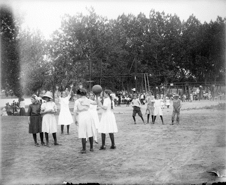 """10. """"Children play and stand on a playground at a school in Denver, Colorado."""""""