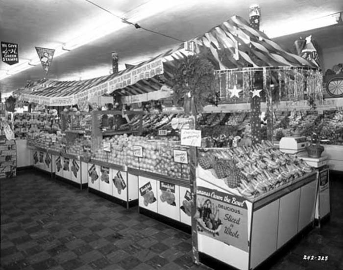 13. In 1956, the fruit stand was certainly extravagant at the Red Owl Store.