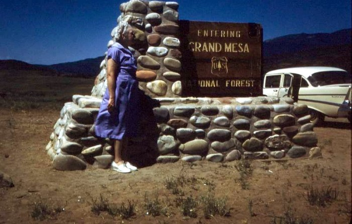 """2. """"Leona standing by the sign holder that Grandpa Crockett made. A few years ago, it still held the sign, but some rocks were falling down. It's somewhere on the road between Vega Dam and Silt."""" (1960)"""