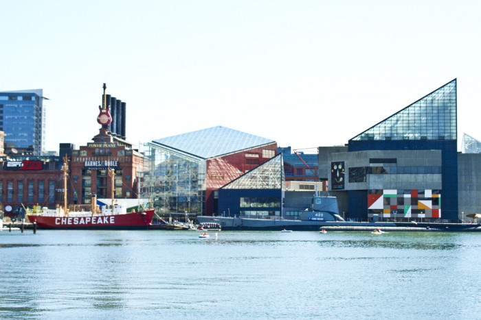 2. The Baltimore Inner Harbor. This includes the iconic triangular glass roof of the aquarium and red Chesapeake boat.