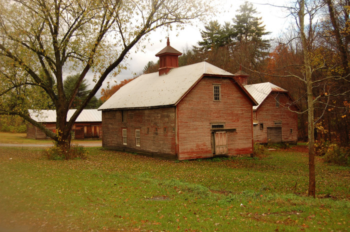 7. This rust-colored barn blends into its surroundings beautifully.