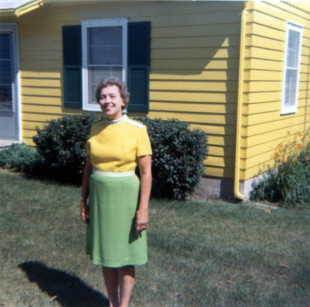 4. This woman in Waterloo poses in front of her bright yellow house in a matching yellow shirt. Oh the 70s.