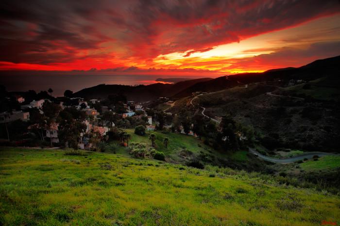 3.  A blazing red sunset ignites the sky over Malibu.