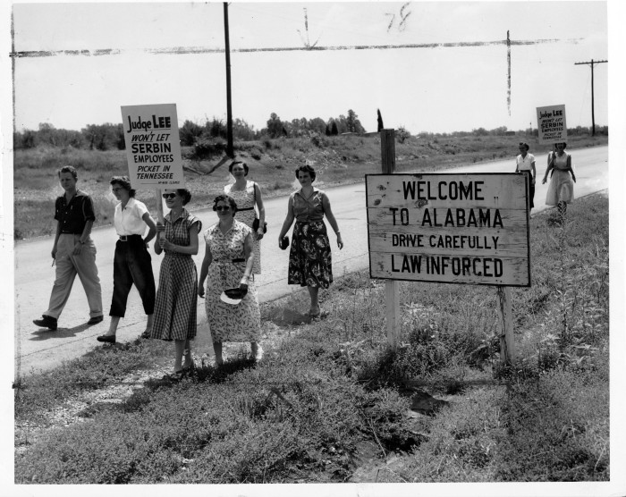 """11. Circa 1955---Picketers on the Alabama-Tennessee border carry signs that read, """"Judge Lee won't let Serbin employees picket in Tennessee."""""""