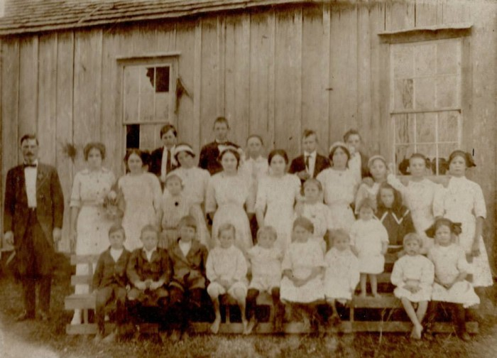 6. Teacher Ida Boyd poses with her class in 1915 at Hancock County's Dead Tiger School.