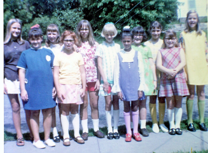 6. These school girls from Dubuque gather up for a quick photo in their first day of school outfits in 1970.