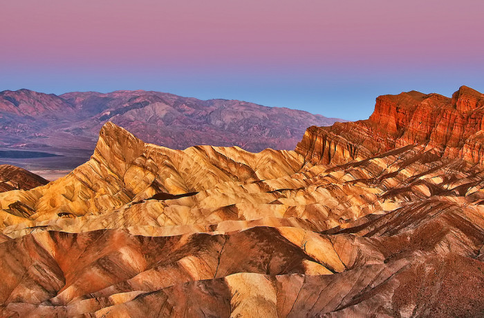 15. How about some rock climbing in Death Valley as the sun starts to rise?