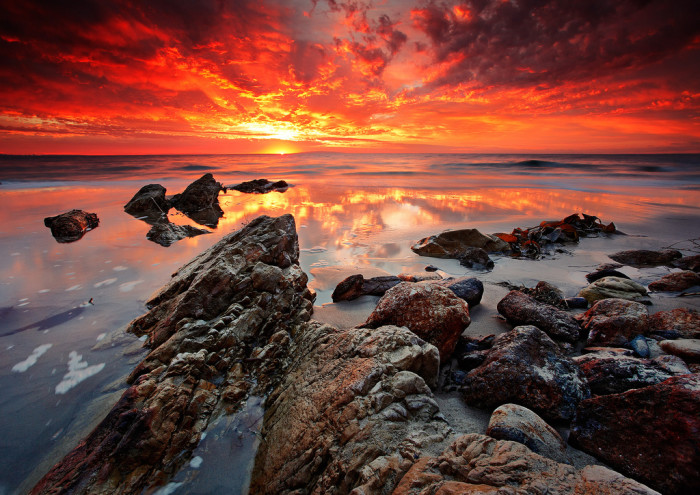 15.  A smoldering sky over the Malibu rocks is quite a stunning sight.