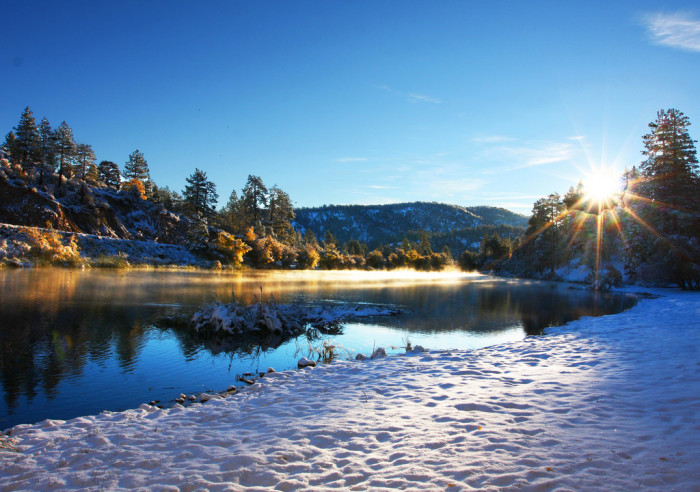 8. A wintery sunrise in Jackson Lake shows off the innocence of fresh, white snow.