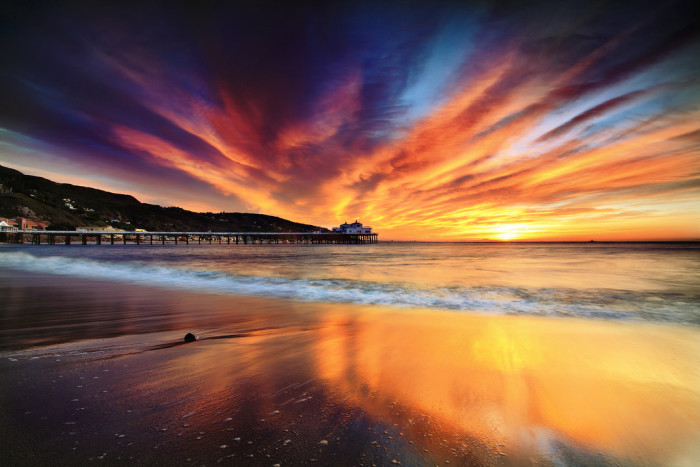13.  A cloud covered sky bursting with color in Malibu.