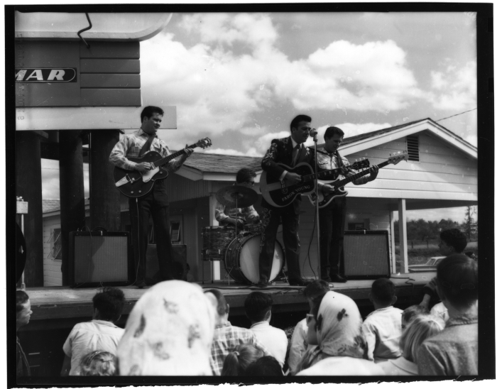 7. Taken in 1963, country music star Faron Young is captured serenading a Jackson crowd.