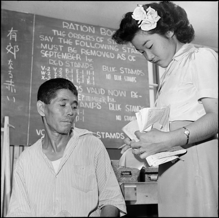 6. Taken at the end of the war, this man is getting ready to head home after spending a significant amount of time at the Gila River internment camp.