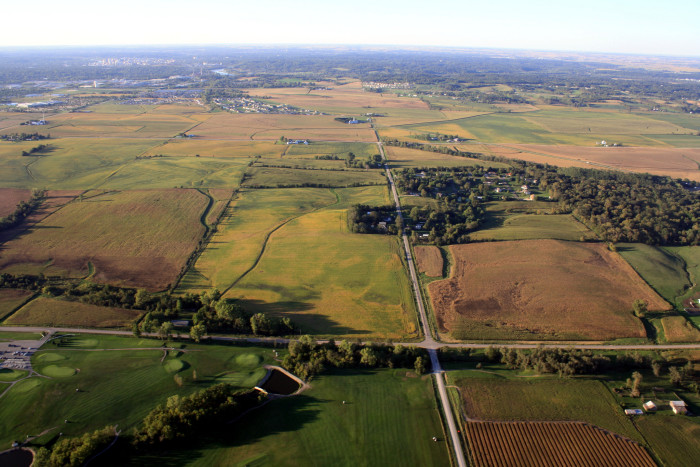 7. This view from the sky shows the bright green fields and farms near Iowa City.