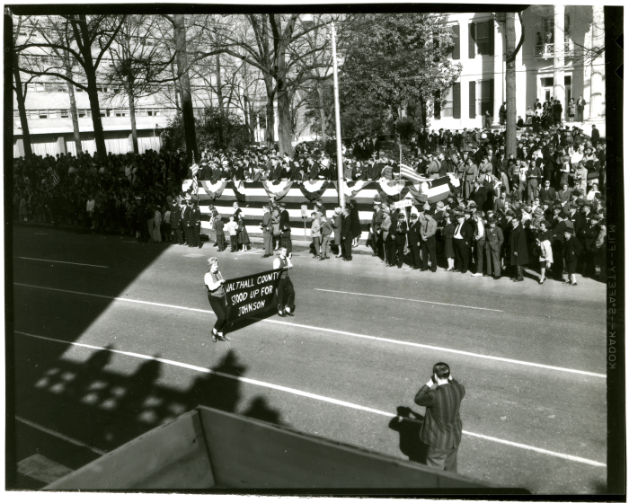 8. A crowd gathers in 1964 for Governor Paul Johnson's inaugural parade and ceremonies.
