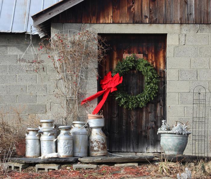 4.  A festive wreath dresses up a barn door for the holidays.