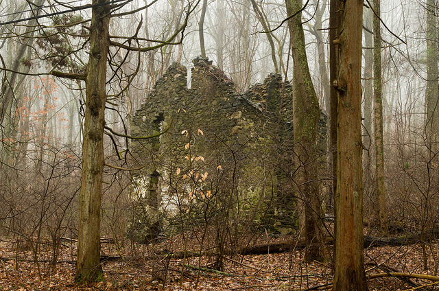 9. An austere two-story stone house has stood abandoned since 1964.