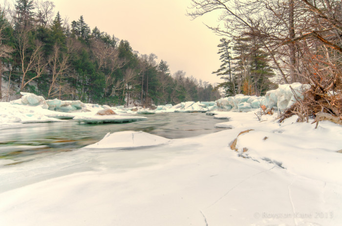 4. Snow makes the colors along this river pop.