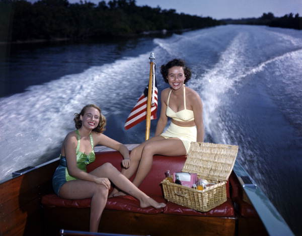 19. Lois Duncan Steinmetz (left) and Polly Gaines in a motorboat: Sarasota, 1950