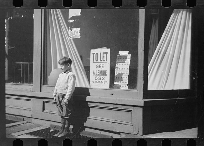 5. A little boy waits in Hillsborough.