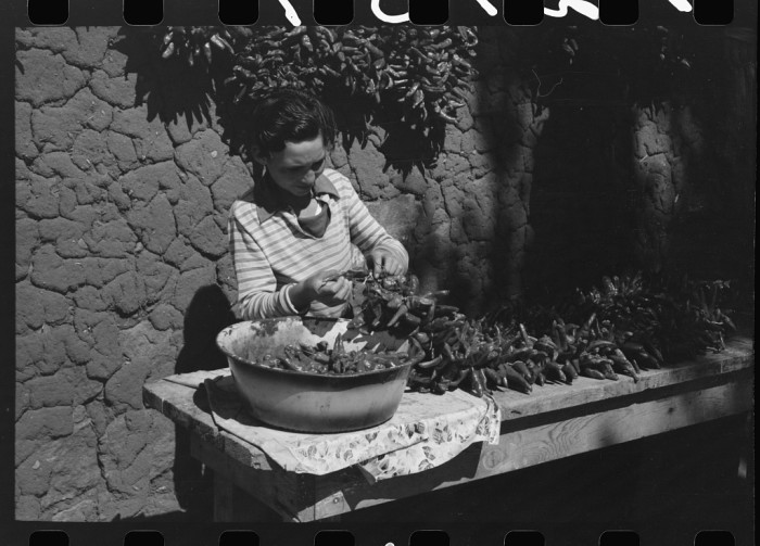 8. The final step before selling the chiles: stringing them up in ristras then hanging them on the side of the home to dry.