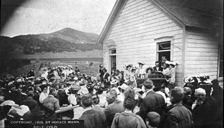 """3. """"Glass lantern slide depicting a Sunday Service with guest speaker President Theodore Roosevelt at the Little Blue School House in Raven."""""""