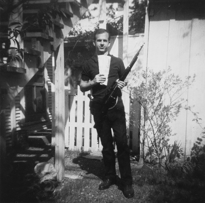 4. Lee Harvey Oswald poses with his new rifle in 1963.