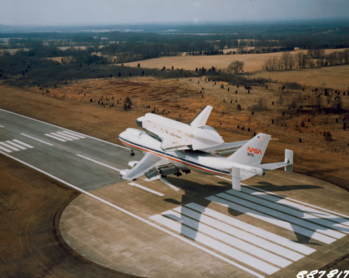 6. The Space Shuttle Orbiter 101 Enterprise approaches riding atop its 747 carrier aircraft and arrives at the Redstone Arsenal airstrip near Marshall Space Flight Center in Huntsville, Alabama on March 13, 1978.