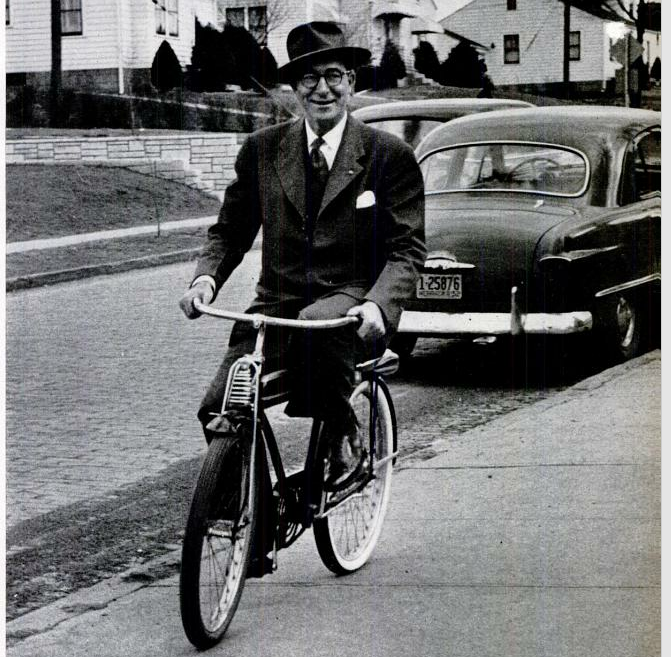 5. Two-time presidential candidate Estes Kefauver rides a bike down an Omaha street in 1952.