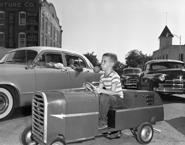 20. Unidentified boy in a go-kart in a parade: Quincy, October 1953