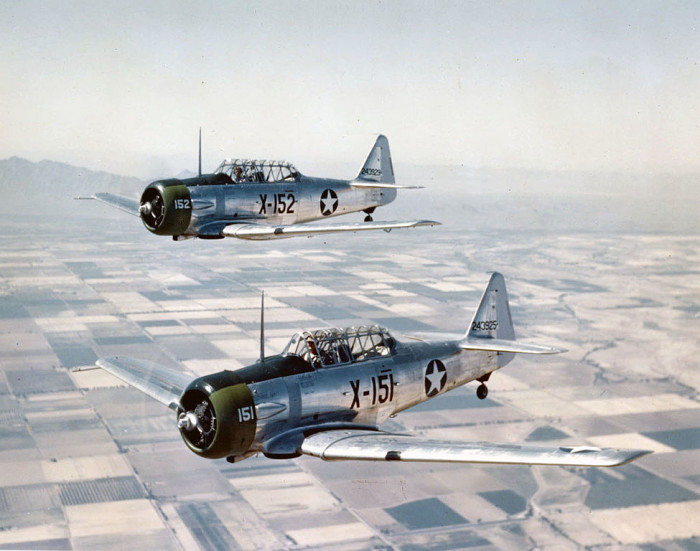 2. These two T-6 Texans aircraft were being used for training pilots at Luke Field (now known as Luke Air Force Base) in 1943.