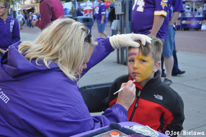 7. He may be young, but he clearly knows enough to be losing all hope for a Vikings victory. Either that or he just really doesn't like face paint.