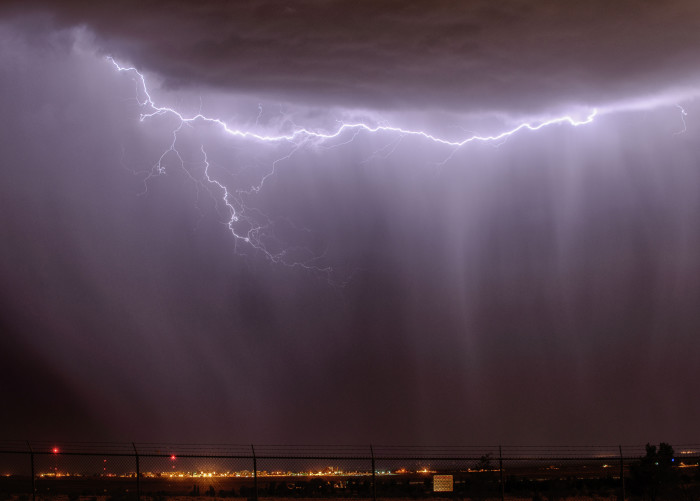 16. Lightning overwhelms the glow from the lights of Albuquerque.