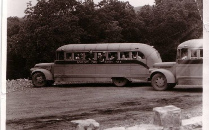 Early tour group bus.